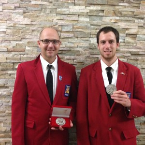 PowerSports instructor and SkillsUSA advisor Kent Reisenauer (left) and 2nd place winner Zach Ehresman