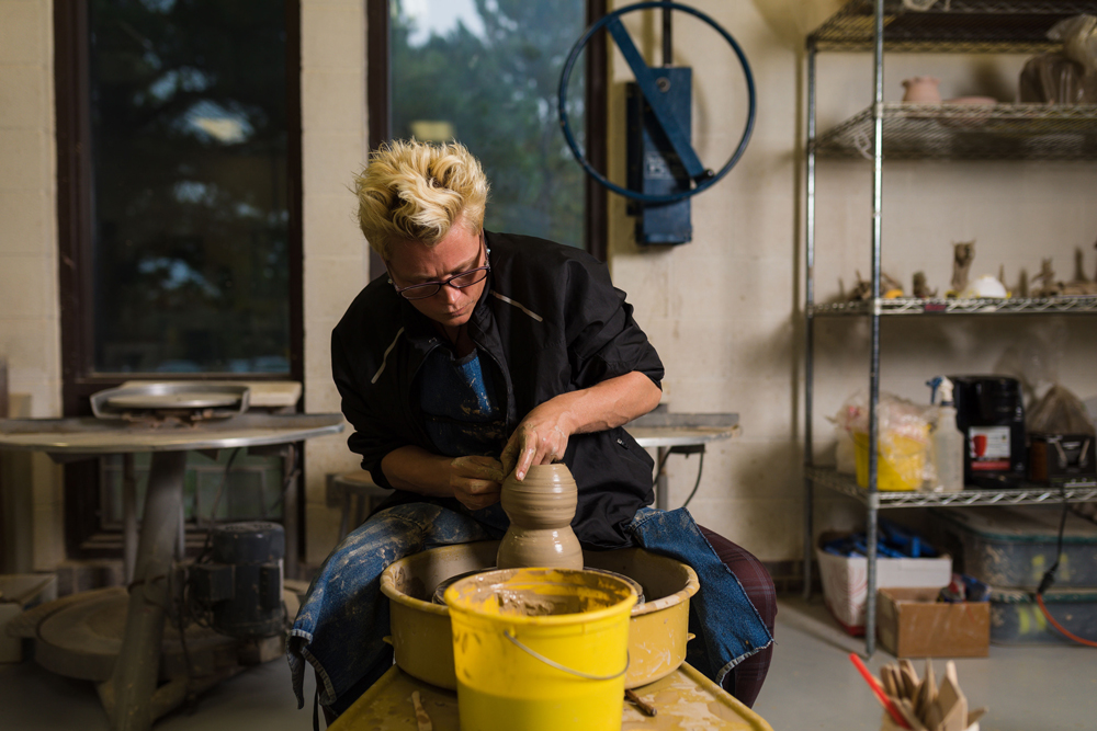 Trista Simon works in the M State ceramics lab.