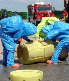 People handling hazardous waste
