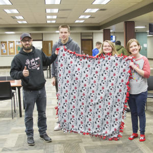 Students make blankets for non-profit
